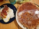 huge pancakes and a side of eggs bacon and hashbrowns
