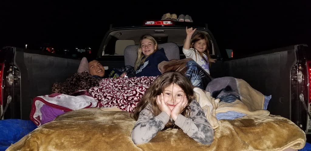 kids in a truck bed at the drive-in theater