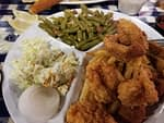 shrimp and fish plate with green beans and coleslaw