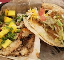 jerk chicken with mango taco and fried avocado taco