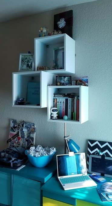 Three boxed shelves on the wall