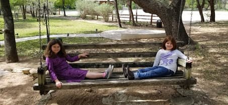 girls on extra large porch swing