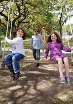 girls on extra large swing