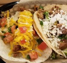 chicken tender and pork tacos